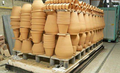 Horno cargado de piezas variadas