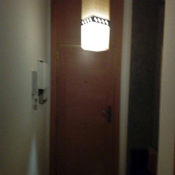 Forrado y cambio cerradura puerta entrada