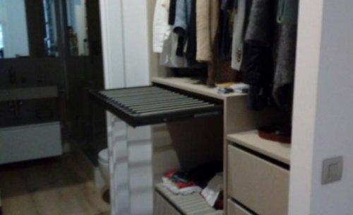 armario a medida habitación con pantalonero extraible