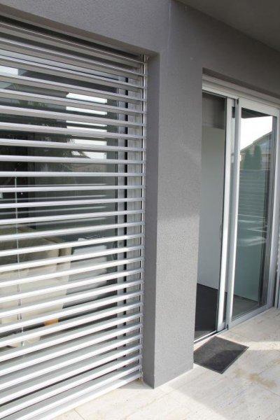 Ventanas de aluminio, persianas de control solar
