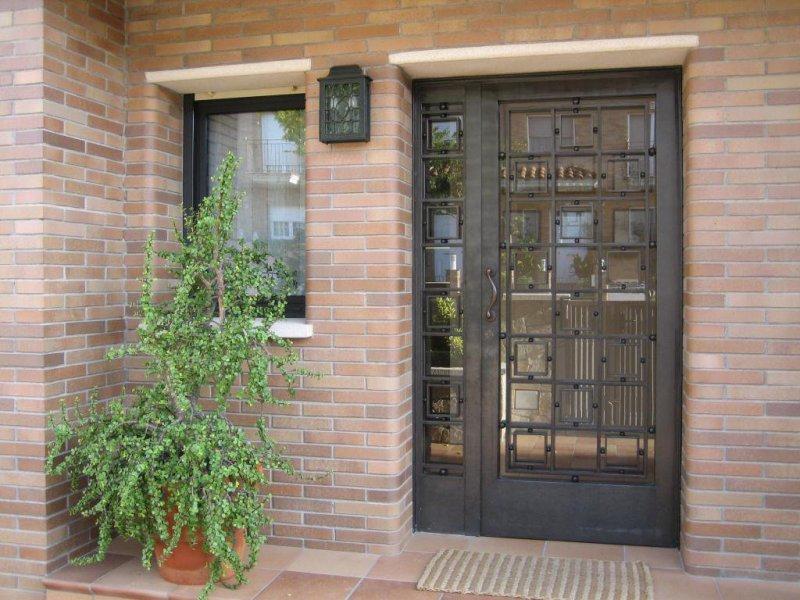 puertas de hierro forjado con diseños personalizados