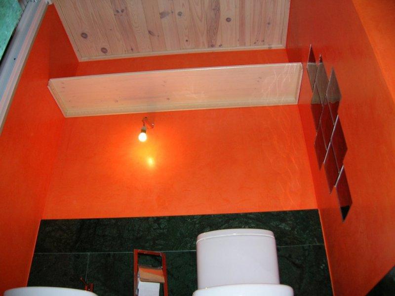 Terminación de vidrios y paramentos en estuco para baño.