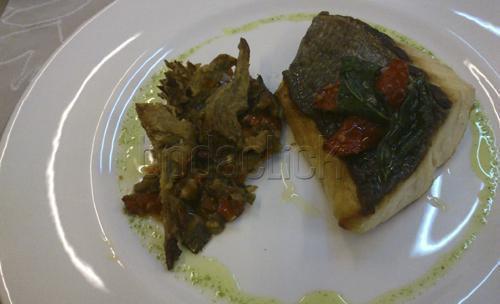 Uno de sus platos de pescado