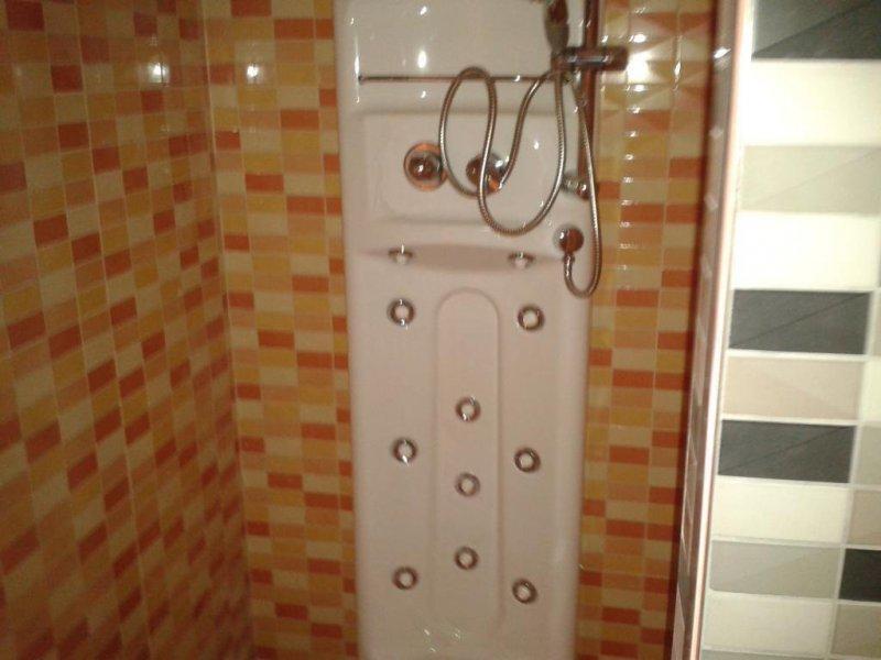 cabinas de ducha con materiales de obra