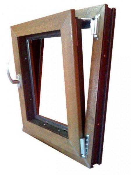 Ventanas 5 camaras de PVC con refuerzo madera imitación madera.