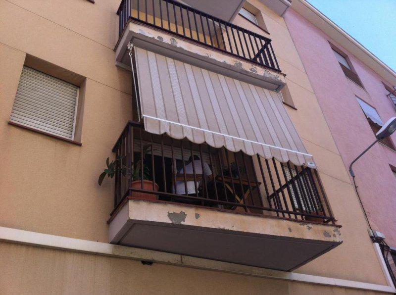 Toldo tipo telón para balcones