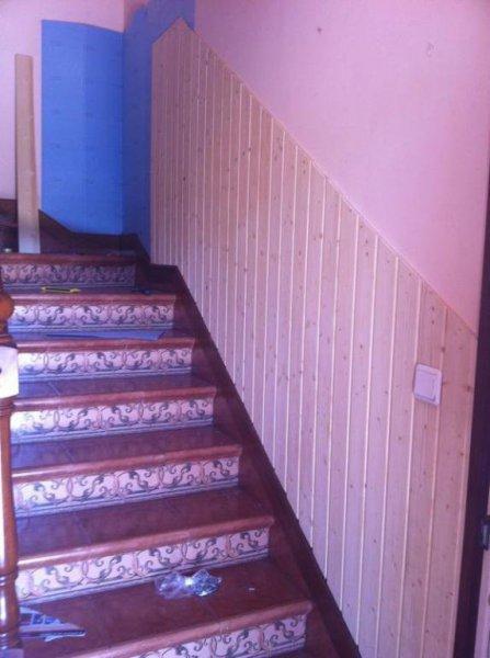 Colocación madera en escalera