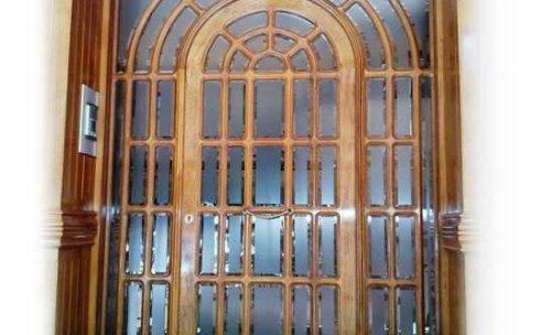 PUERAS - Puerta exterior vivienda, acabados artesanales