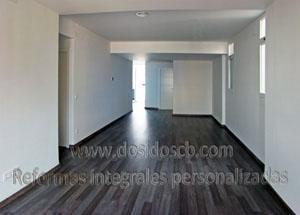 Dosidos CB reforma de interior blanco y parquet gris, salón minimal en Valencia