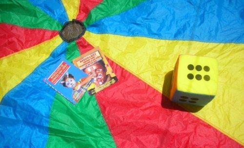 Juegos con paracaídas y pinta-caras